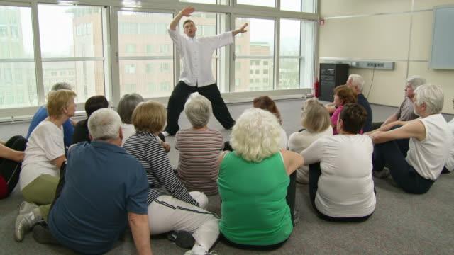 HD DOLLY: Seniors Watching Tai Chi Exercises