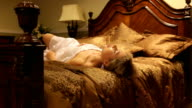 Sensual beautiful woman tossing and turning in her sleep