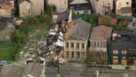 Sept 12 2005 aerial collapsed building in wake of Hurricane Katrina / zoom out skyline / New Orleans