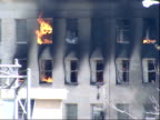 September 11 2001 PAN Fire and smoke pouring out of destroyed portion of the Pentagon after the terrorist attack / Arlington Virginia United States