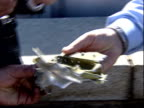 September 11 2001 TS Onlooker finding piece of aircraft wreckage and giving to police after terrorist attack on Pentagon / Arlington Virginia United...