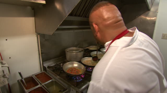 September 14 2009 MS Chef cooking in restaurant kitchen / New Mexico United States