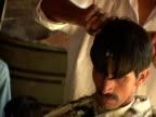 September 15 2005 CU ZO MS Customer having hair cut in barber shop / Peshawar Pakistan / AUDIO