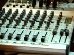 September 15 2005 CU ZO MS Woman in hijab using mixer in recording studio / Kabul Afghanistan / AUDIO