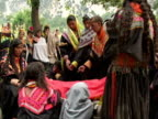 September 15 2005 WS ZI CU Women in traditional clothing guarding body in funeral / Chitral Pakistan / AUDIO