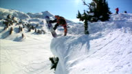 September 17 2009 MONTAGE Professional snowboarder executing a handplant off a deep cliff