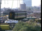 PUBLISHED LIB September 1997 EXT Damaged rail coach on crane hoist as being removed from scene