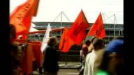 East London Docklands Excel Centre Antiwar protestors march near Excel Centre
