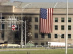 September 21 2001 PAN Damage at the Pentagon with American flag draped against the building / Arlington Virginia United States