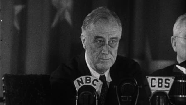 September 23 1944 B/W CU Franklin D Roosevelt delivering speech joking that Republicans not only attack him his wife and his sons but also his little...