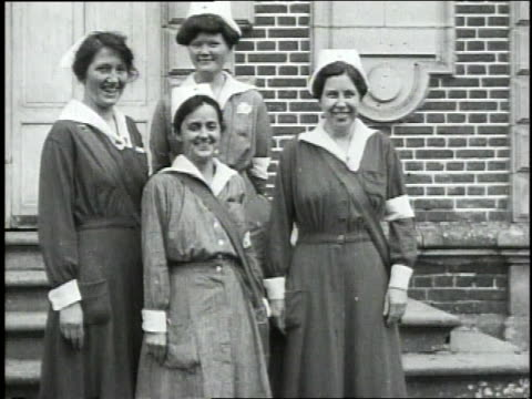 September 30 1918 MONTAGE Medics and nurses posing on steps / Neuvilly France