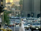September 4 1990 WS Pedestrians and vehicle traffic on a busy city street / Baghdad Iraq