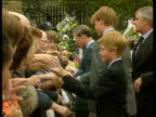 September 5 1997 FILM MONTAGE MS Prince Harry Prince William and Prince Charles outside Kensington Palace after death of Princess Diana/ MS William...