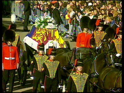 September 6 1997 FILM MONTAGE MS Carriage with Princess Diana's casket and guards passing in front of spectators/ MS casket and flowers/ CU Flowers...