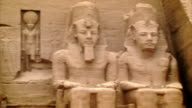 Sequence highlighting the statues decorating the exterior of the Great Temple of Ramesses II at Abu Simbel, Southern Egypt.