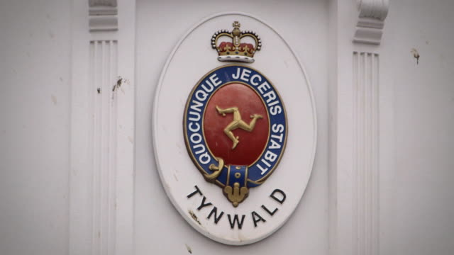Sequence of closeup views of signs and flags on the Isle of Man's government building the Tynwald in Douglas following allegations that the Isle of...