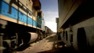 Sequence showing a cargo train carrying iron ore in Mauritania.