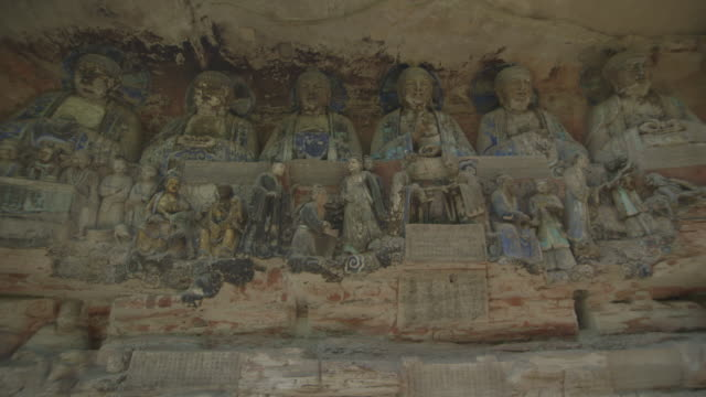 Sequence showing a large, detailed Dazu relief carving depicting families of the Tang Dynasty, Chongqing Municipality, Sichuan Province, China.