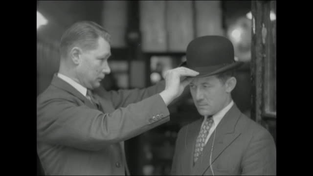 Sequence showing a man being fitted for a new bowler hat in a hat shop