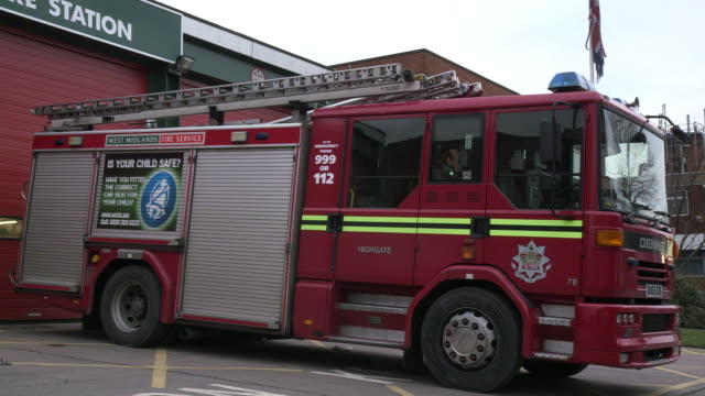 Sequence showing a West Midlands Fire Service fire engine parked outside Highgate Community Fire Station, Birmingham, UK.