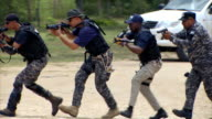 Sequence showing anti-narcotics police of the Dominican Republic (DICAN) training for armed ambush.