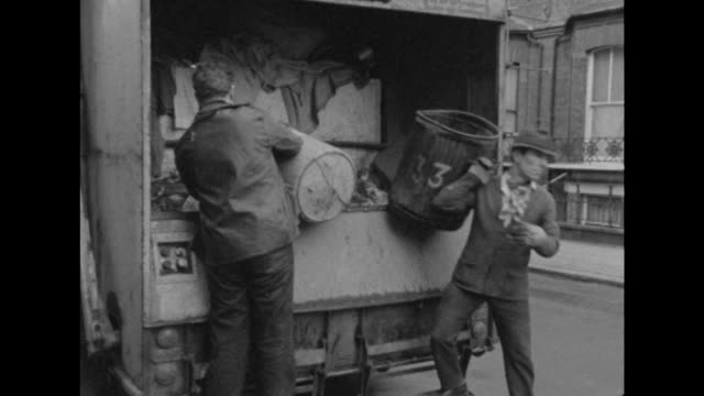 Sequence showing binmen collecting rubbish from the streets of London