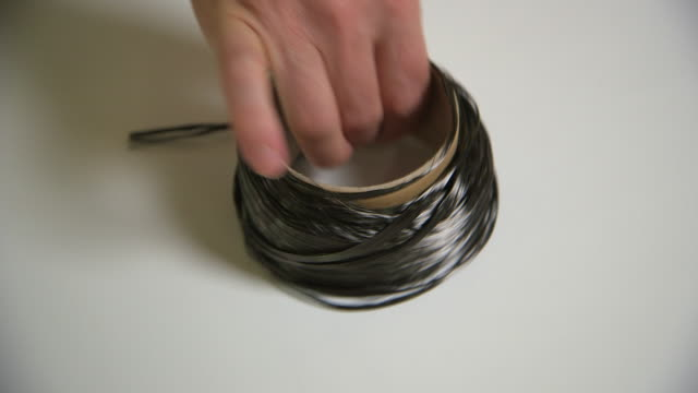 Sequence showing carbon filament on a roll and strong tubes made from carbon fibre and epoxy, UK.