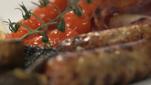 Sequence showing close-ups of a cooked breakfast, UK.