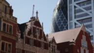 Sequence showing contrasting buildings, including the 'Gherkin', from Bishopsgate in the City, London, UK.