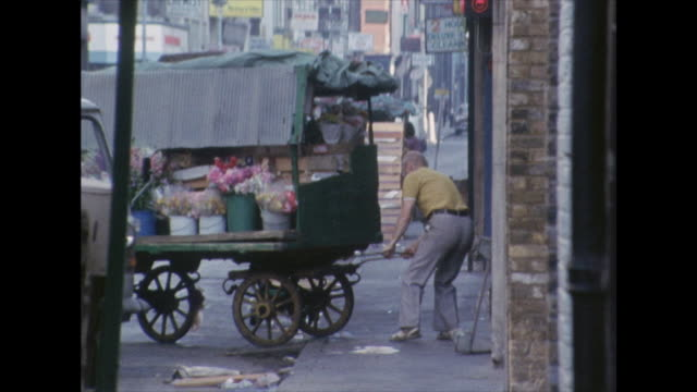 Sequence showing market traders preparing their stalls in London's Soho district