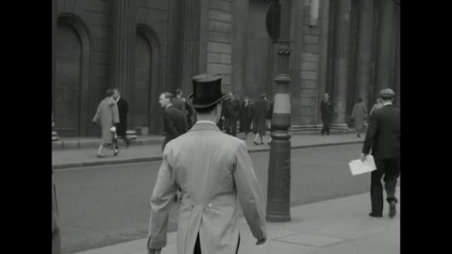 Sequence showing men wearing various hats in central London