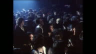 Sequence showing punk rockers at a concert in a club