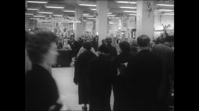 Sequence showing shoppers browsing the goods at Lewis's department store Birmingham