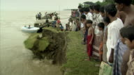 Sequence showing soil breaking away as part of dramatic erosion on the banks of the River Padma (known as the Ganges in India) in Bangladesh.