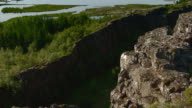 Sequence showing the ancient natural amphitheatre Althing on a fault line between two tectonic plates at Thingvellir National Park, Iceland.