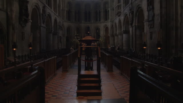 Sequence showing the choir stalls and windows of the the transept of St Bartholomew the Great Church in the City of London, UK.