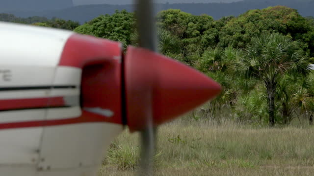 Sequence showing the engine being started and take off of a small aeroplane, Venezuela.