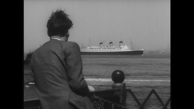 Sequence showing the Queen Mary ocean liner arriving at New York City