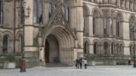 Sequence showing the statue of John Bright, the Albert Memorial and the grand entrance to Manchester Town Hall, UK.