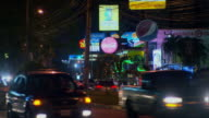 POV sequence showing the streets of San Pedro Sula, Honduras, from a car at night.