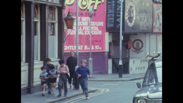 Sequence showing various sex shops and cinemas in London's Soho district