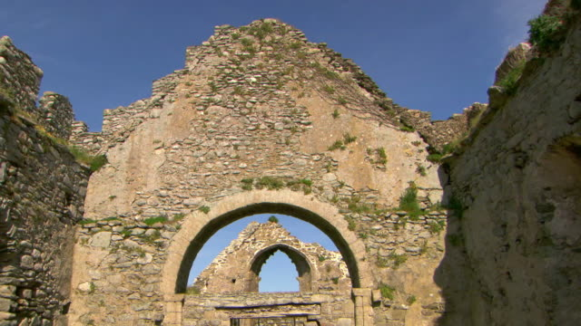 Sequence showing views of the ruined Norman church of the Blessed Virgin Mary and its relation to Bannow Bay, County Wexford, Republic of Ireland.