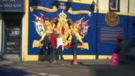 Sequence showing visual loyalist/unionist gestures of allegiance to the UK in July 2015 on the streets of Belfast, Northern Ireland.