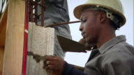 Sequence showing young people training on the job at a building site as part of Jamaica's Citizen Security Justice Programme.