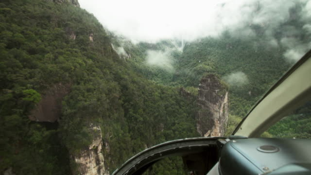POV sequence taken from a helicopter flying over a Tepui mountain, Venezuela.
