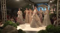 Sequined and sparkling bridal wear dominates the runway at the final day of Pakistan Fashion Week in Karachi