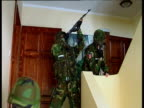 Serbian security police armed with AK-47s move in for raid on house Belgrade; 2003