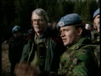 Serbian/Moslem agreement MS PM John Major along towards accompanied by UN soldiers CMS Soldier talking Major TILT DOWN mud MS Soldiers at checkpoint...
