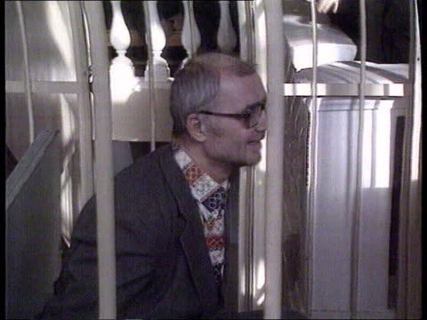 Serial Killer Andrei Chikatilo RUSSIAN FED Rostov CMS Alleged serial killer Andrei Chikatilo up stairs with police officers and into caged dock for...