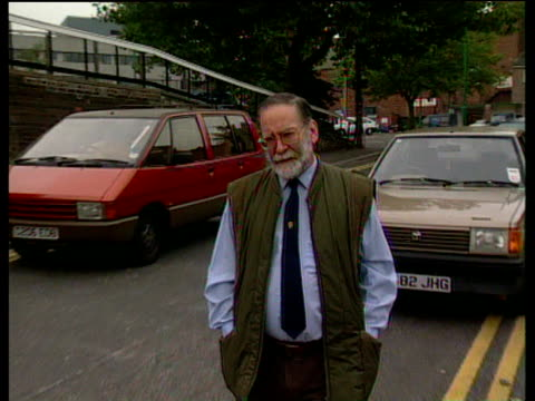 Serial killer Harold Shipman walks across street to camera Sep 98